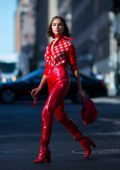 Olivia Culpo in all red wearing MSGM with a Tods handbag in New York City