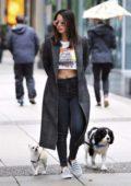 Olivia Munn was spotted out for a rainy day stroll with her two dogs during break from shooting in Vancouver, Canada