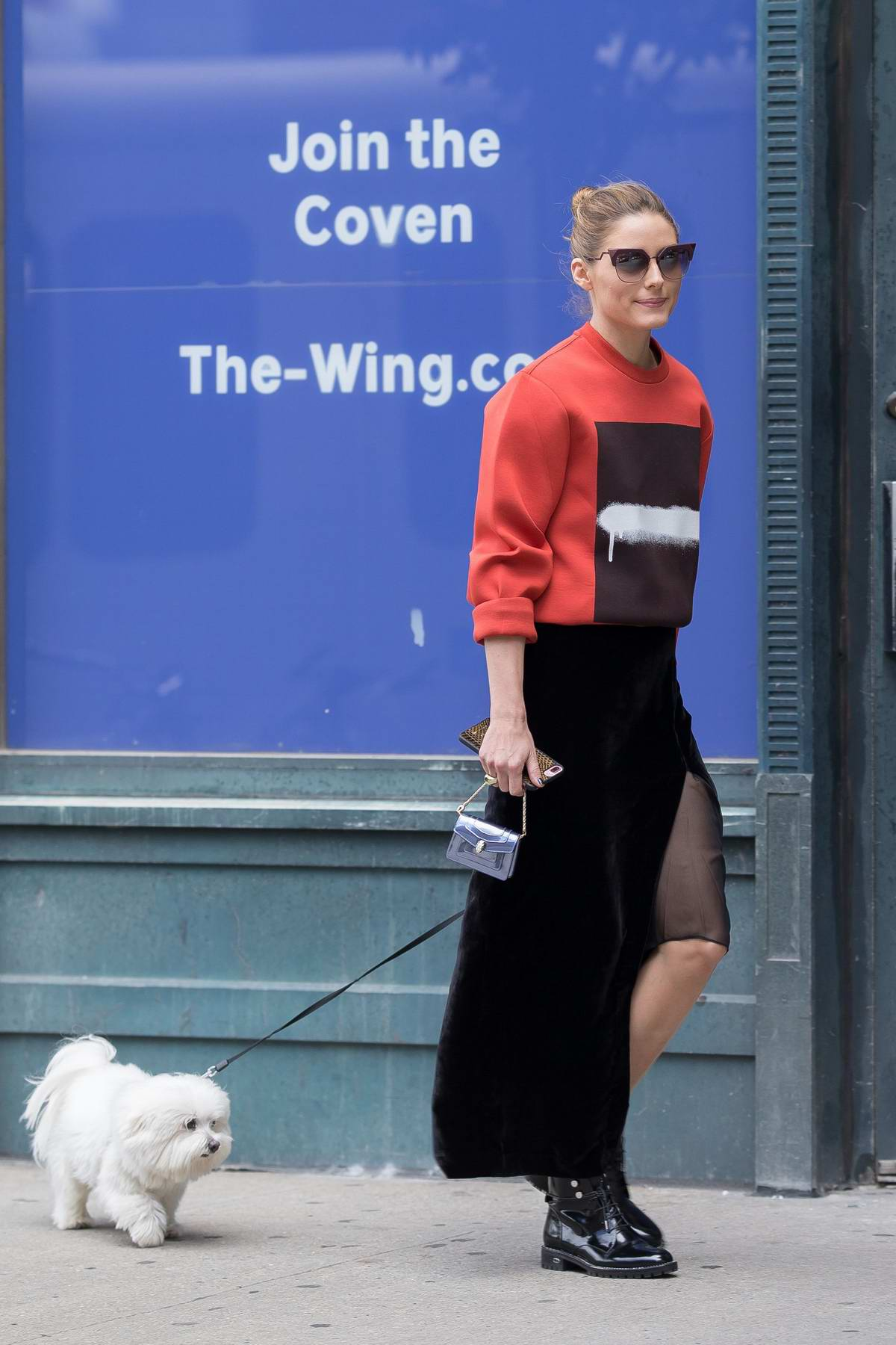 Olivia Palermo dressed in red and black while running errands in New York City