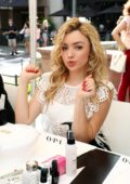 Peyton Roi List at OPI sets Guniness World Record for longest manicure bar in Santa Monica, California