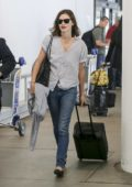 Phoebe Tonkin pulls her suitcase through LAX Airport in Los Angeles