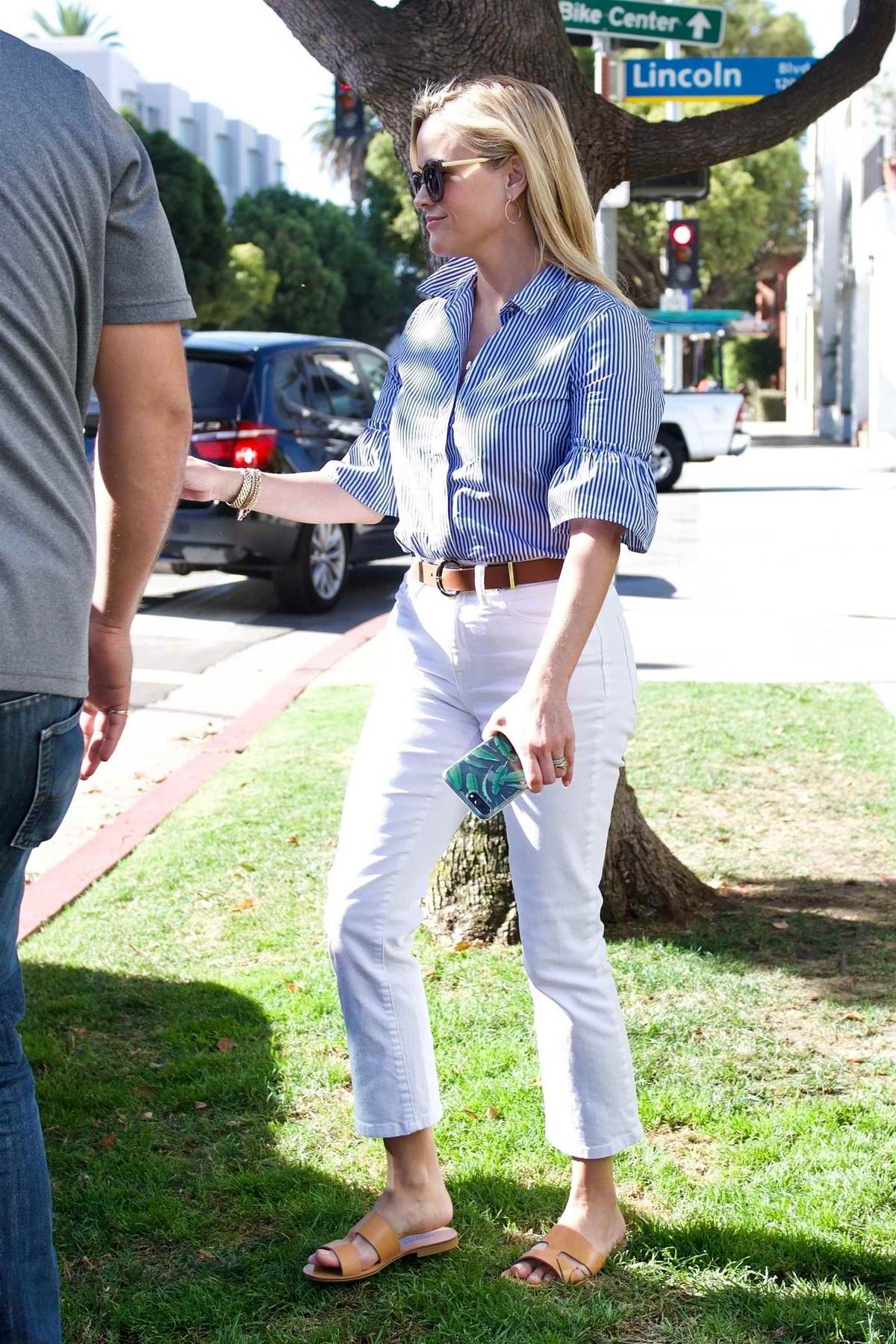 Reese Witherspoon drops her son off at school and then off to a business meeting in Brentwood, Los Angeles