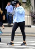 Rihanna busy on her phone while heading to the gym in New York City