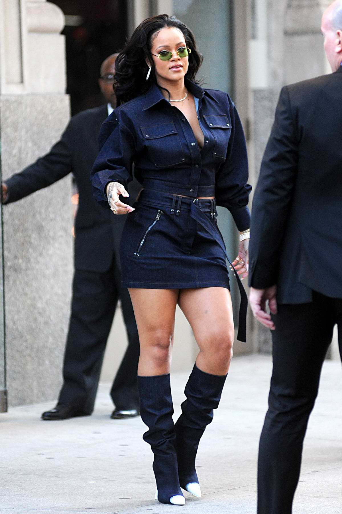 Rihanna in a blue denim outfit out and about in New York City
