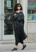 Rihanna wears a black maxi coat in New York City