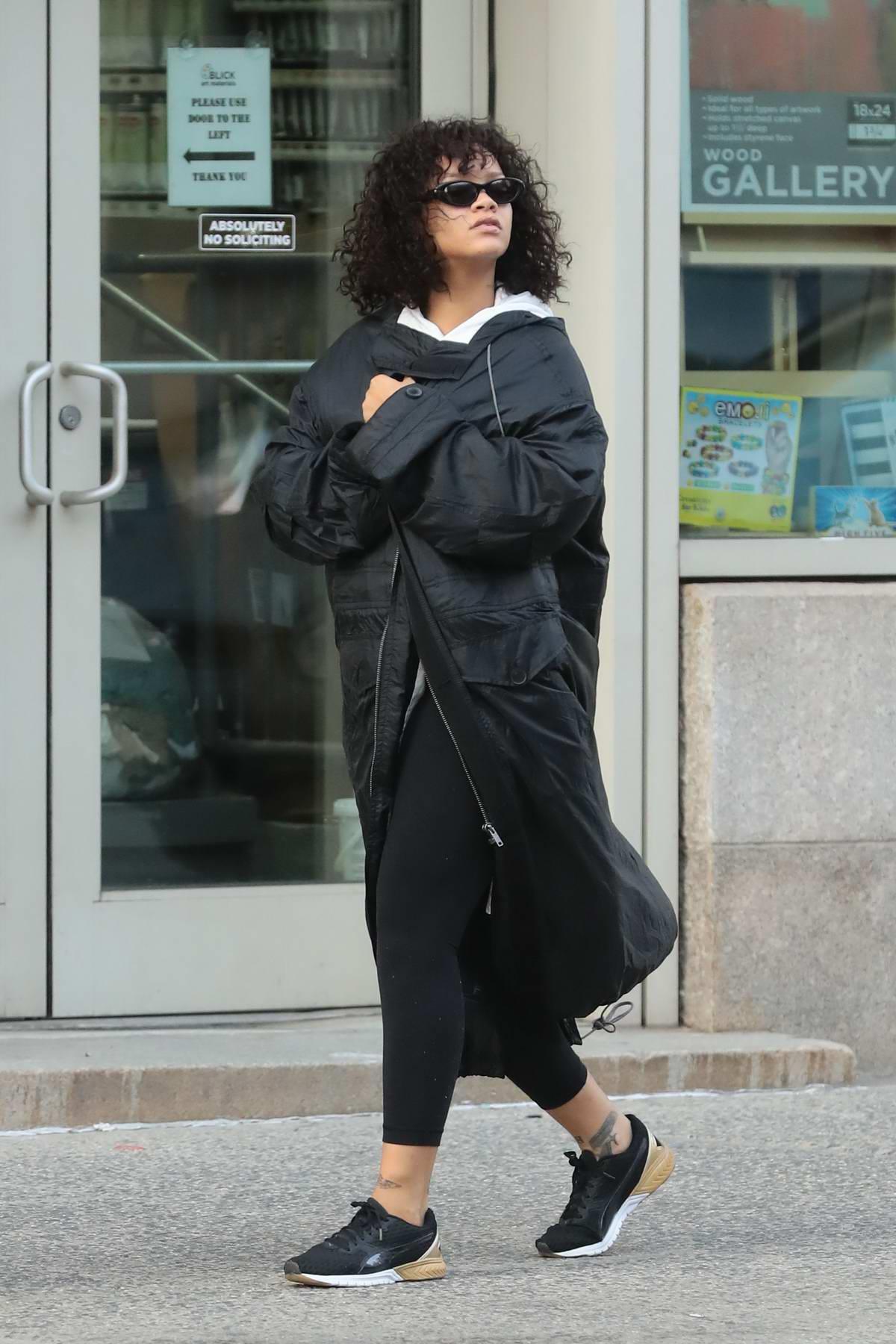 Rihanna wears a black maxi coat in New York City