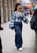 Rihanna wears oversized trousers when departing her apartment in New York