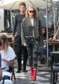 Romee Strijd in camo pants with red boots arrives with her boyfriend at Zinque Cafe for lunch in West Hollywood, Los Angeles