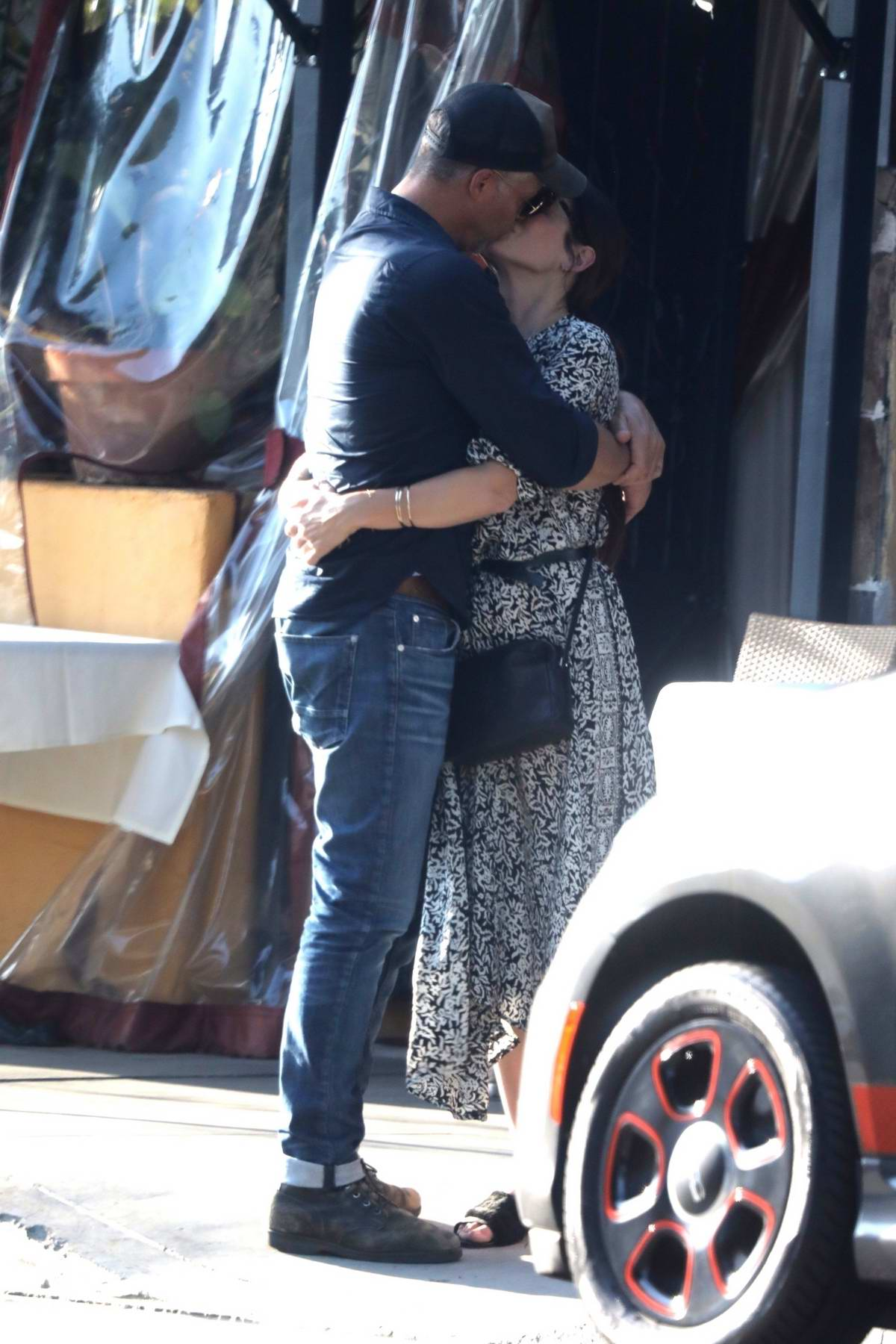 Sandra Bullock and boyfriend Bryan Randall gets cozy while out in Beverly Hills, Los Angeles