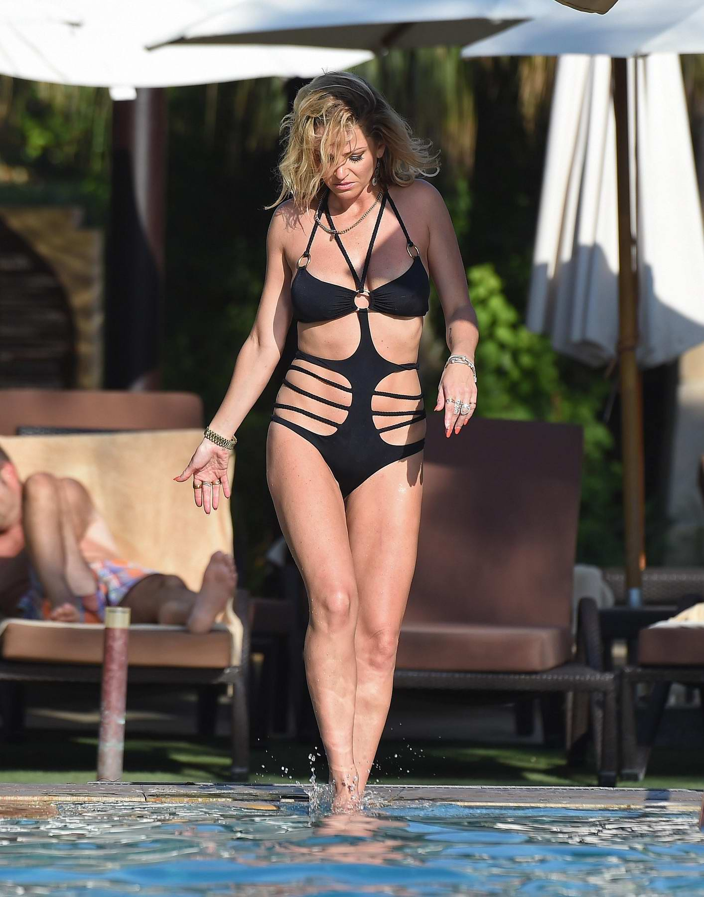 Sarah Harding in a black bikini enjoying holiday in Dubai