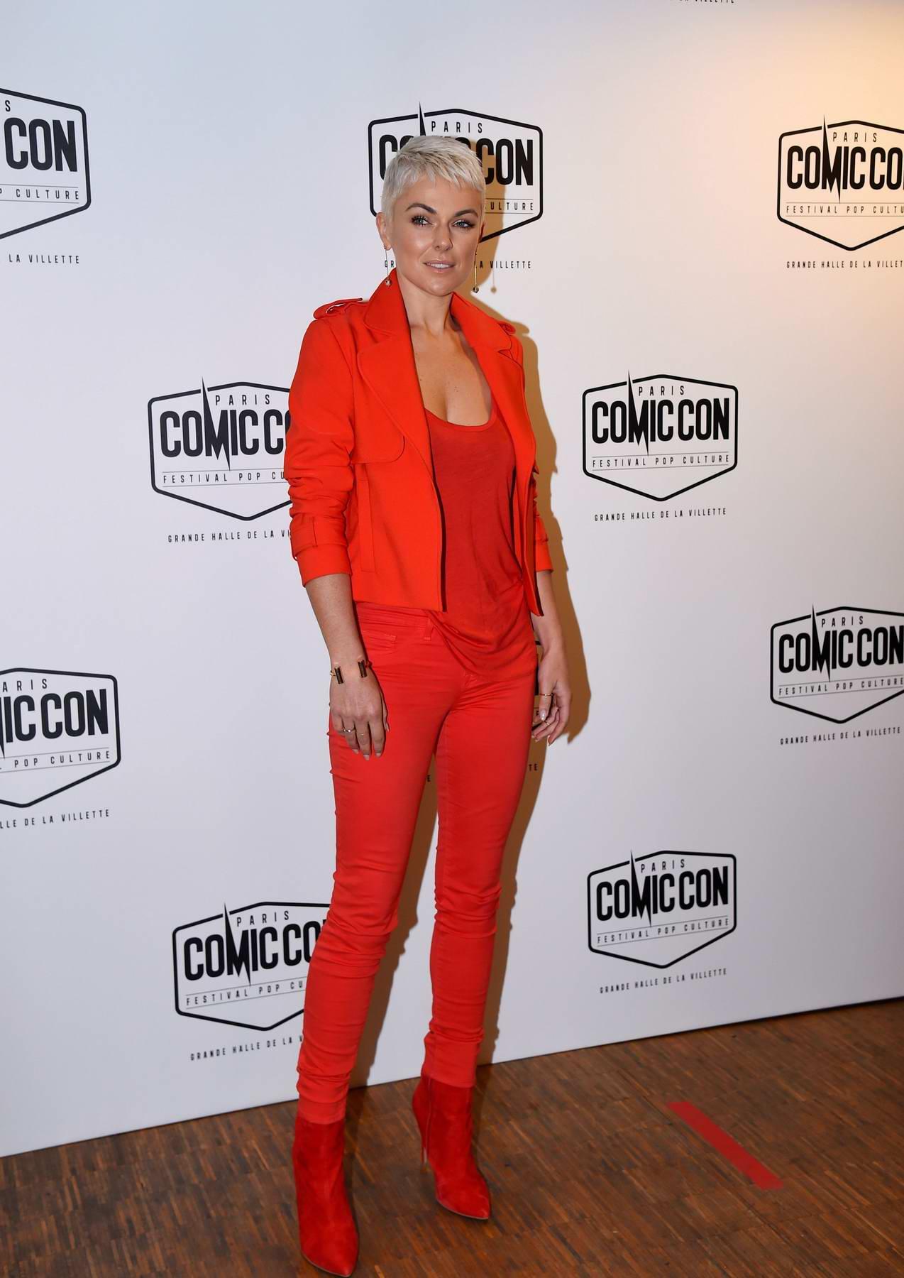 Serinda Swan dressed in red at the Paris Comic-Con at Grande Halle De la Villette, France