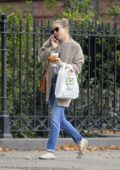 Sienna Miller in a badge faux-fur coat paired with a Chanel striped top and jeans in New York City
