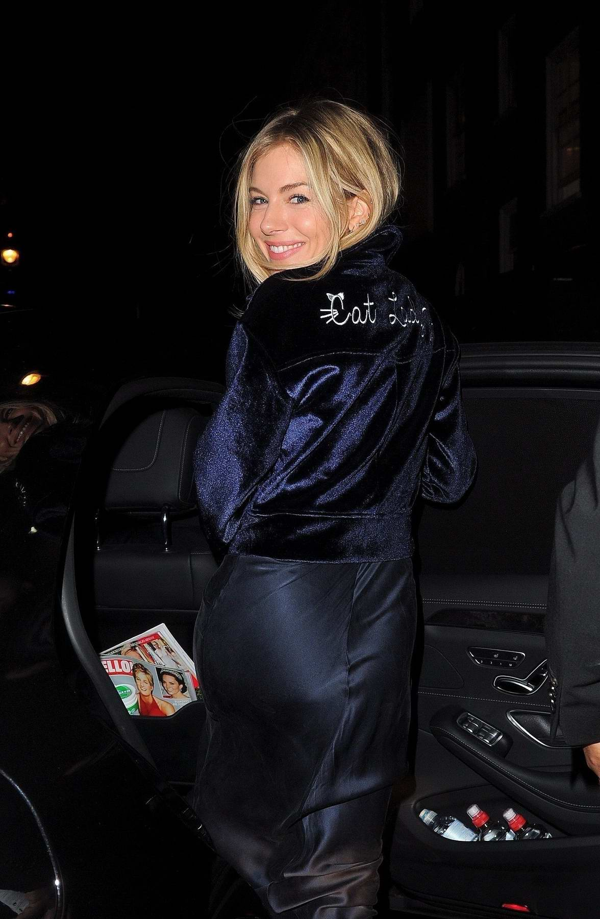 Sienna Miller is seen in a cat lady jacket while leaving the Apollo Theatre in London