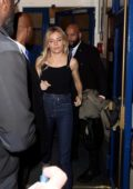 Sienna Miller seen leaving the Apollo Theatre wearing a black top and blue jeans in London