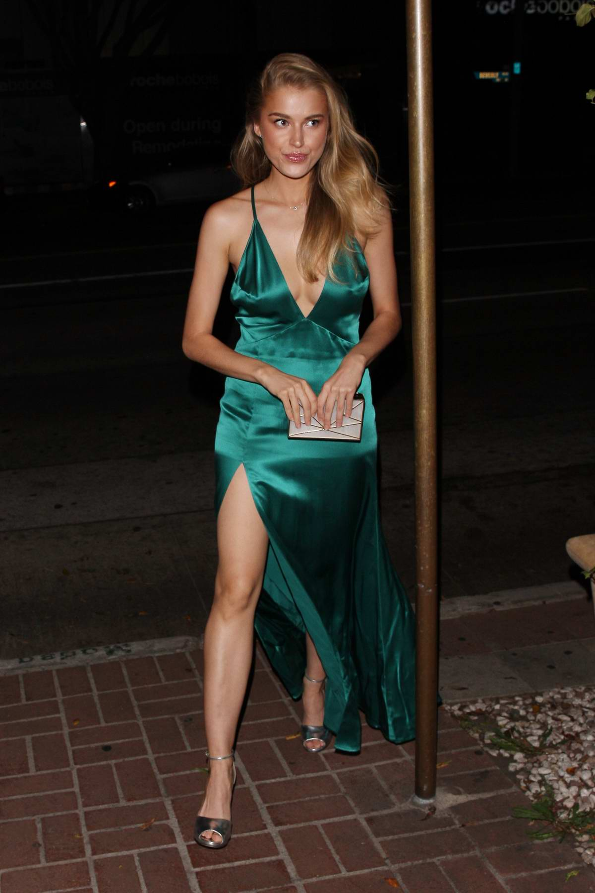Tanya Mityushina seen leaving Madeo Restaurant in a green dress during a night out in West Hollywood, Los Angeles