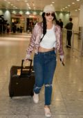 Tulisa Contostavlos pulls her luggage through Customs at Heathrow Airport in London
