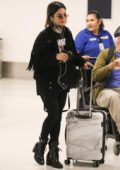 Vanessa Hudgens in an all black outfit arrives at LAX Airport, Los Angeles