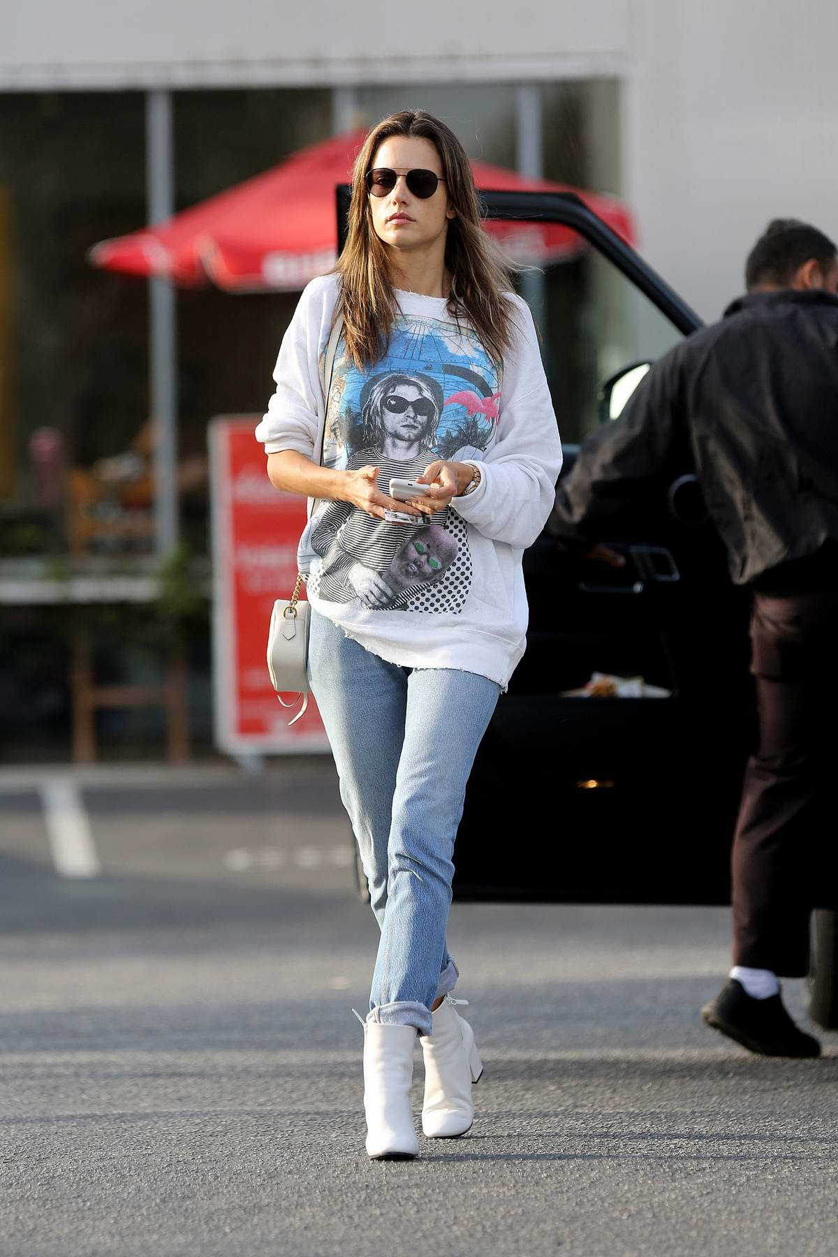 Alessandra Ambrosio dressed in blue jeans paired with white boots while out and about in Los Angeles