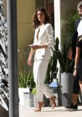 Alessandra Ambrosio wears a white pantsuit as she attends an event at the Omega watch boutique in Miami, Florida