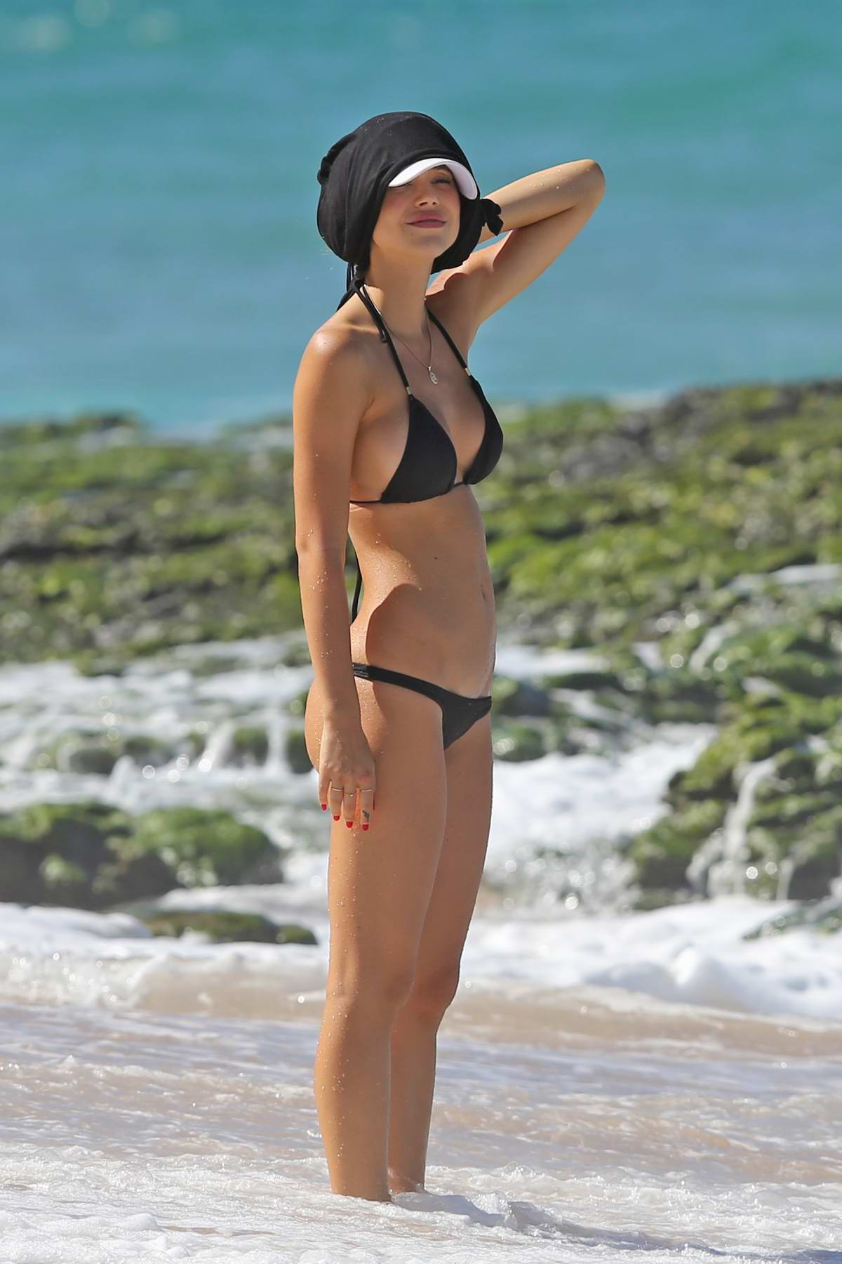 Alexis Ren Wears A Black Bikini While Enjoying The Beach