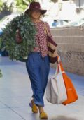 Ali Larter buys a large Christmas wreath from the farmers market in Los Angeles