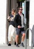 Alice Eve wears a puppy face knit sweater to have breakfast and some shopping with a mystery man in Los Angeles