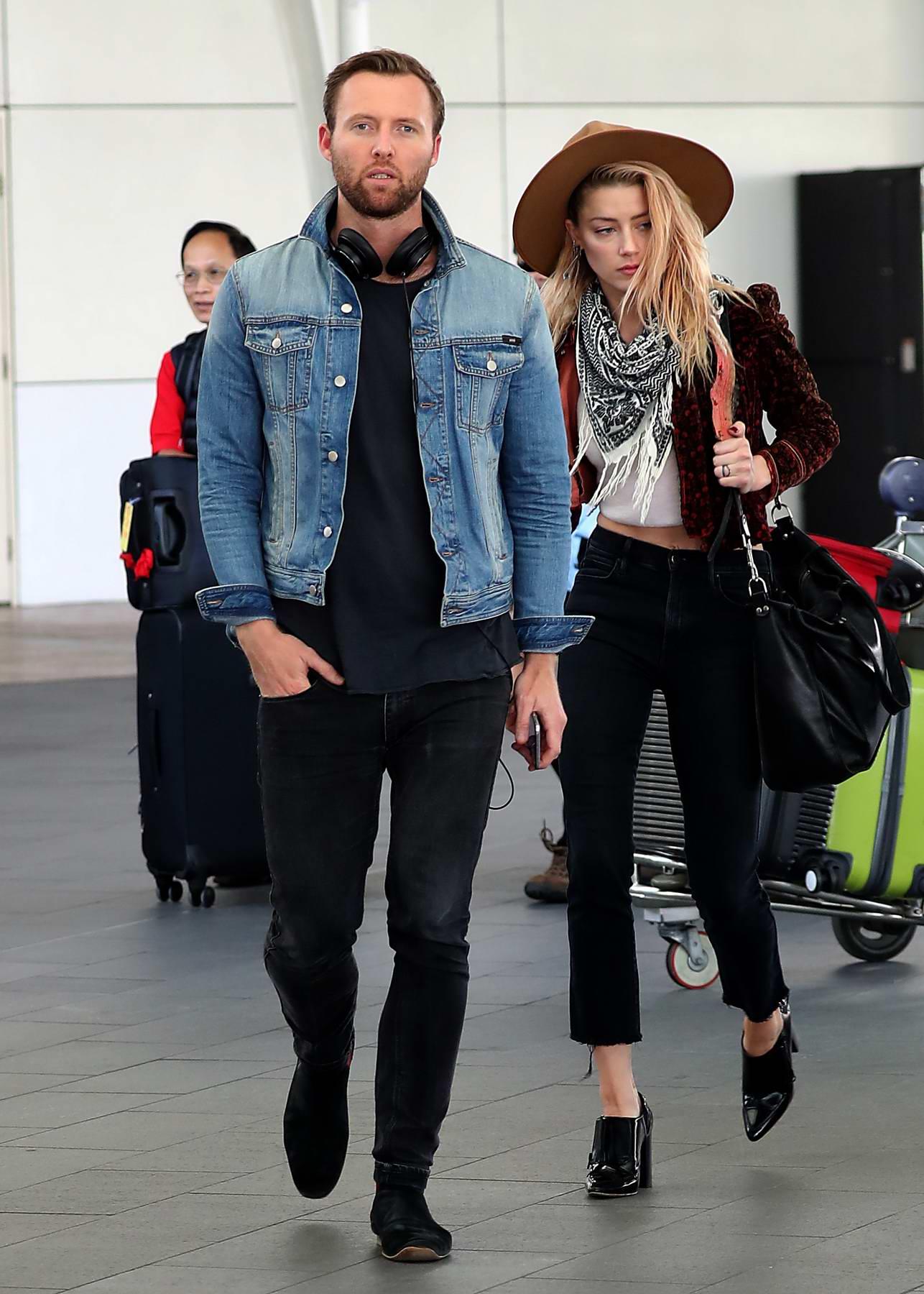 Amber Heard battles the wind as she arrives in Sydney, Australia