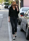Amber Heard heads back to her car after lunch at Cafe Gratitude in West Hollywood, Los Angeles