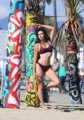Tania Marie in a bikini during a photoshoot for 138 Water in Venice beach, Los Angeles