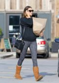 April Love Geary stays warm in her Ugg boots as she grabs some take away food in Malibu, California
