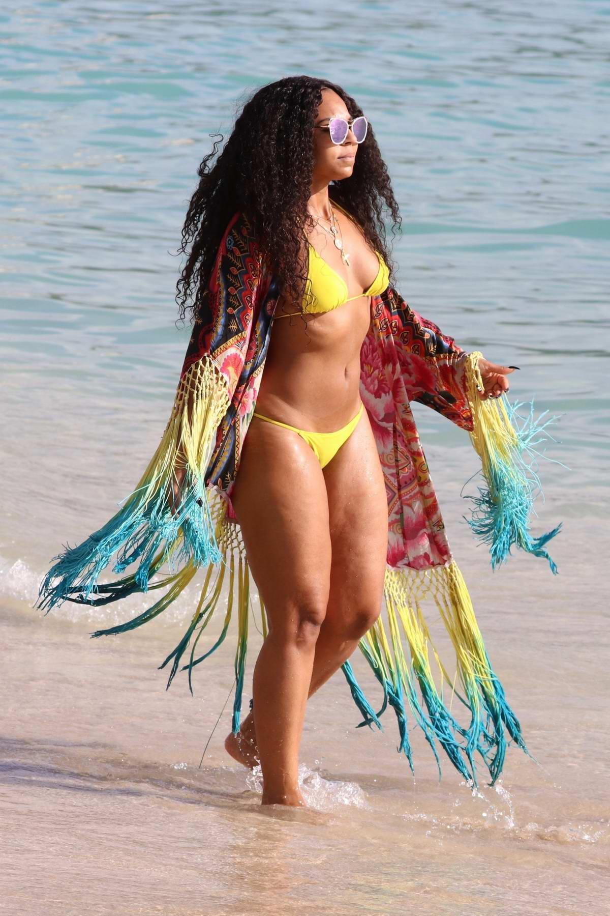 Ashanti in a yellow bikini enjoying a beautiful sunny day on a beach in Hawaii