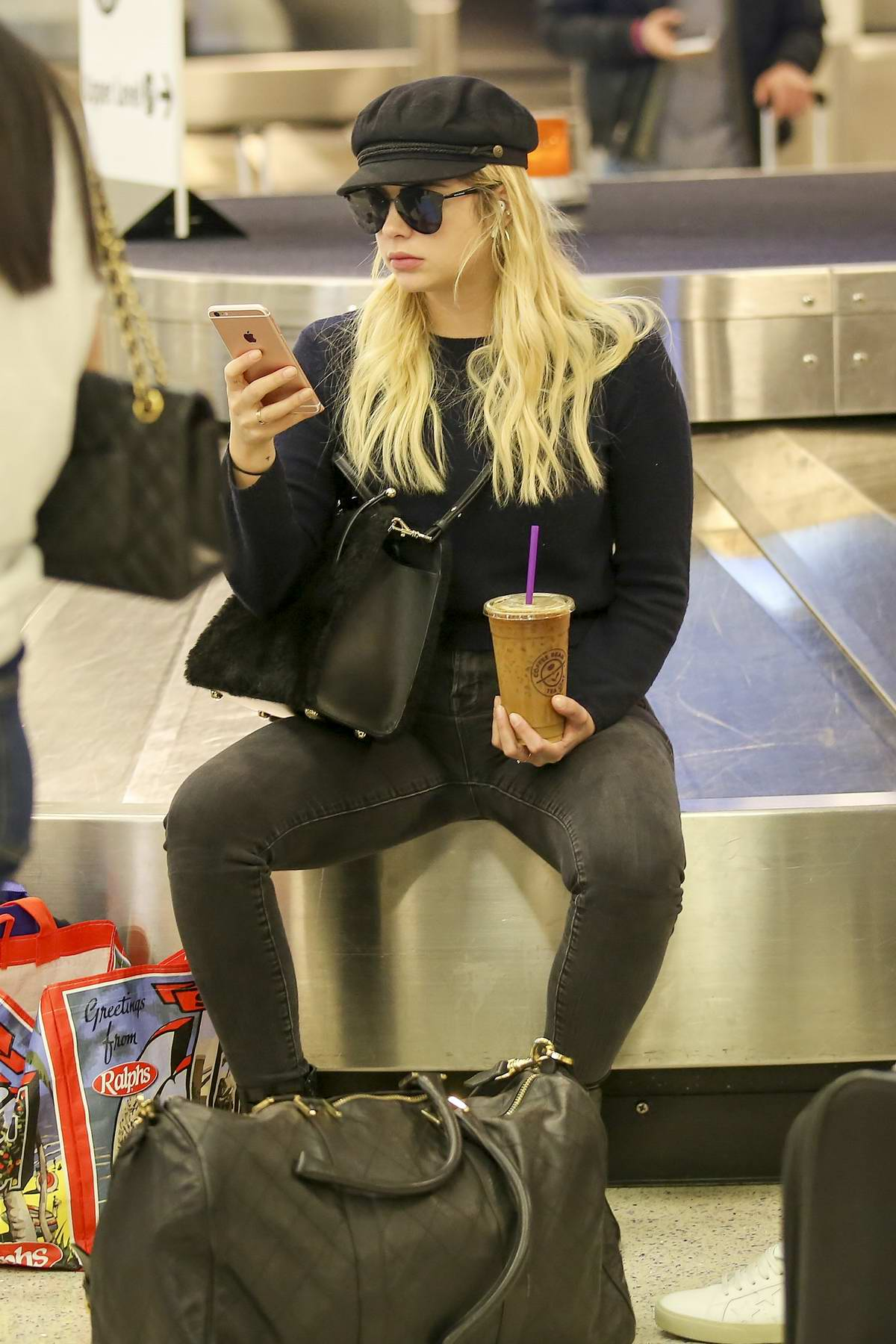 Ashley Benson spotted while waiting for her luggage at LAX airport in Los Angeles