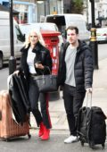 Ashley James and her mystery man spotted with luggage packed on their way to Dubai