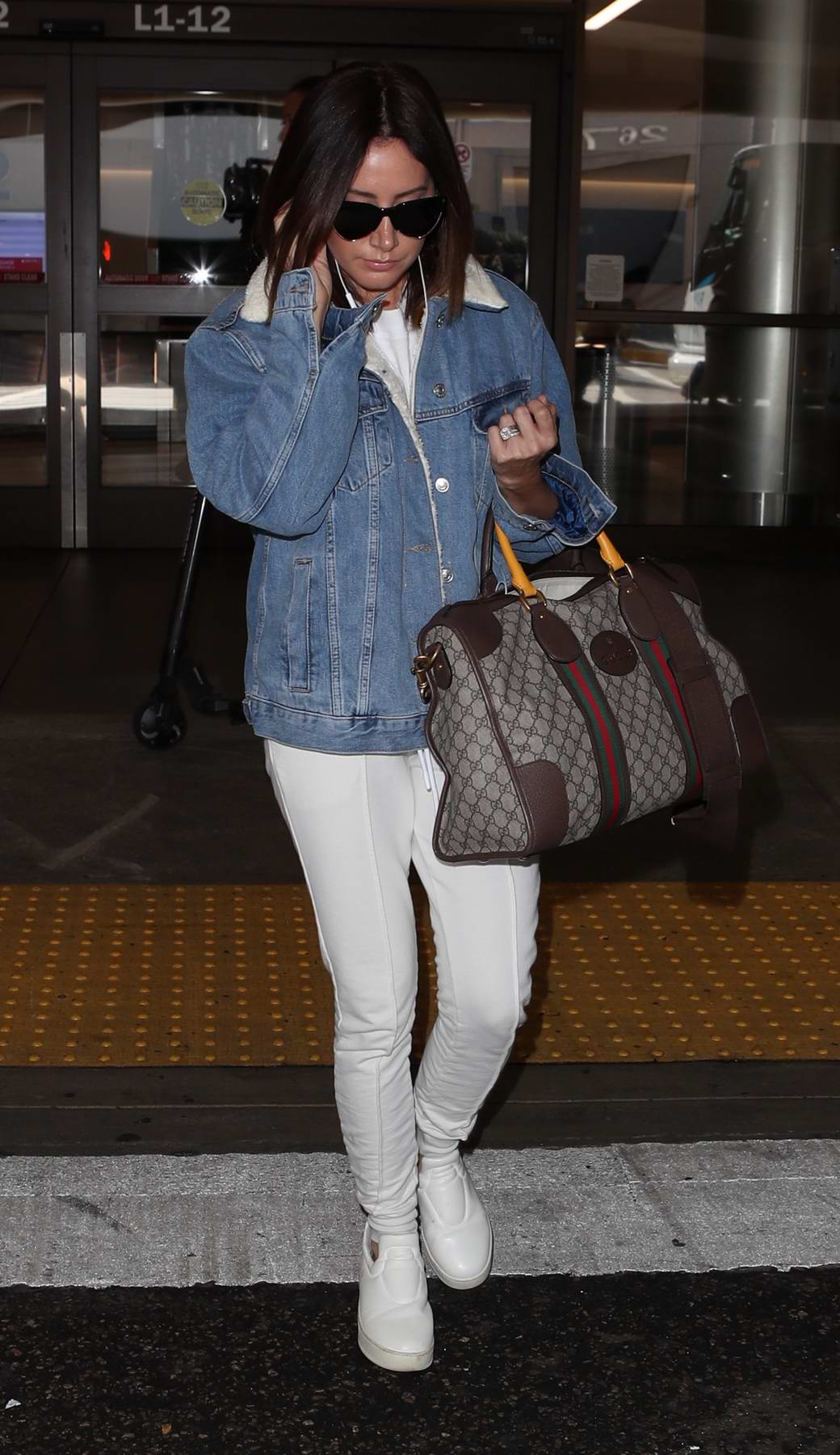 Ashley Tisdale spotted while arriving at LAX Airport in Los Angeles