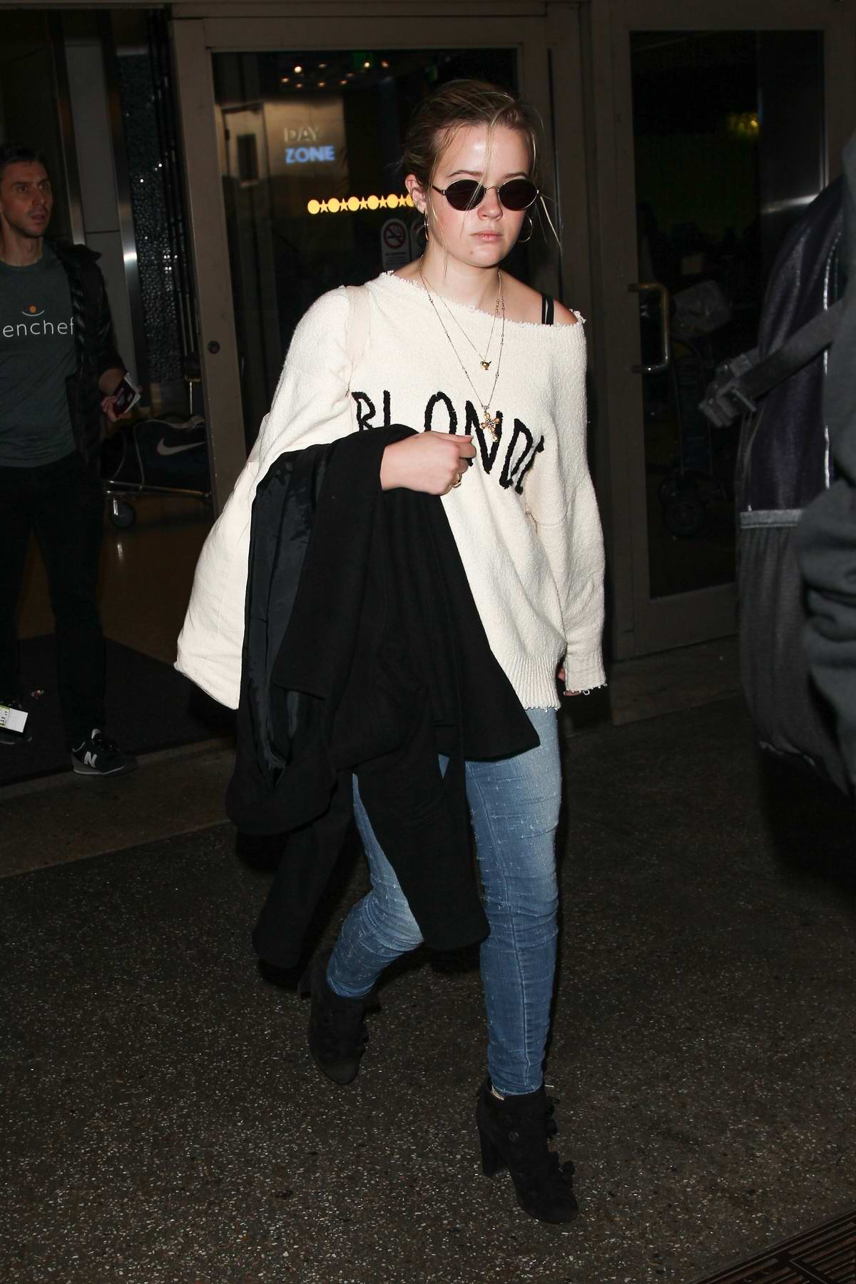 Ava Phillippe with her step-father Jim Toth at LAX International airport arrivals in Los Angeles