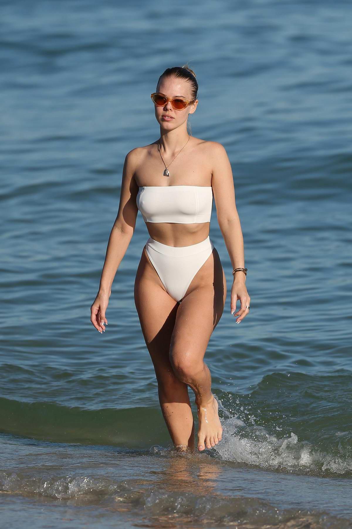 Bianca Elouise in a white bikini enjoying the beach with her boyfriend in Miami, Florida