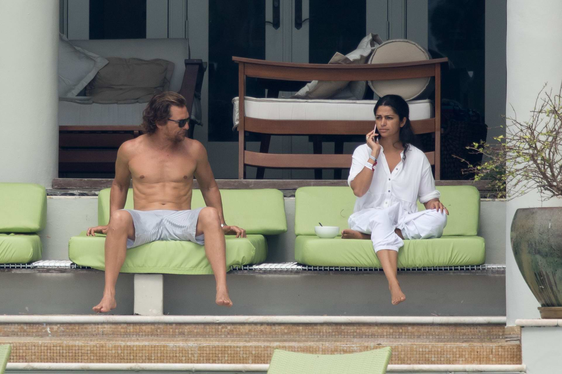 Camila Alves and Matthew McConaughey are spotted relaxing by the pool in Miami