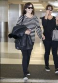 Camilla Belle seen with her mother while leaving LAX Airport in Los Angeles