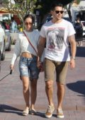 Cara Santana and boyfriend Jesse Metcalfe take the dogs for a weekend stroll in Los Angeles