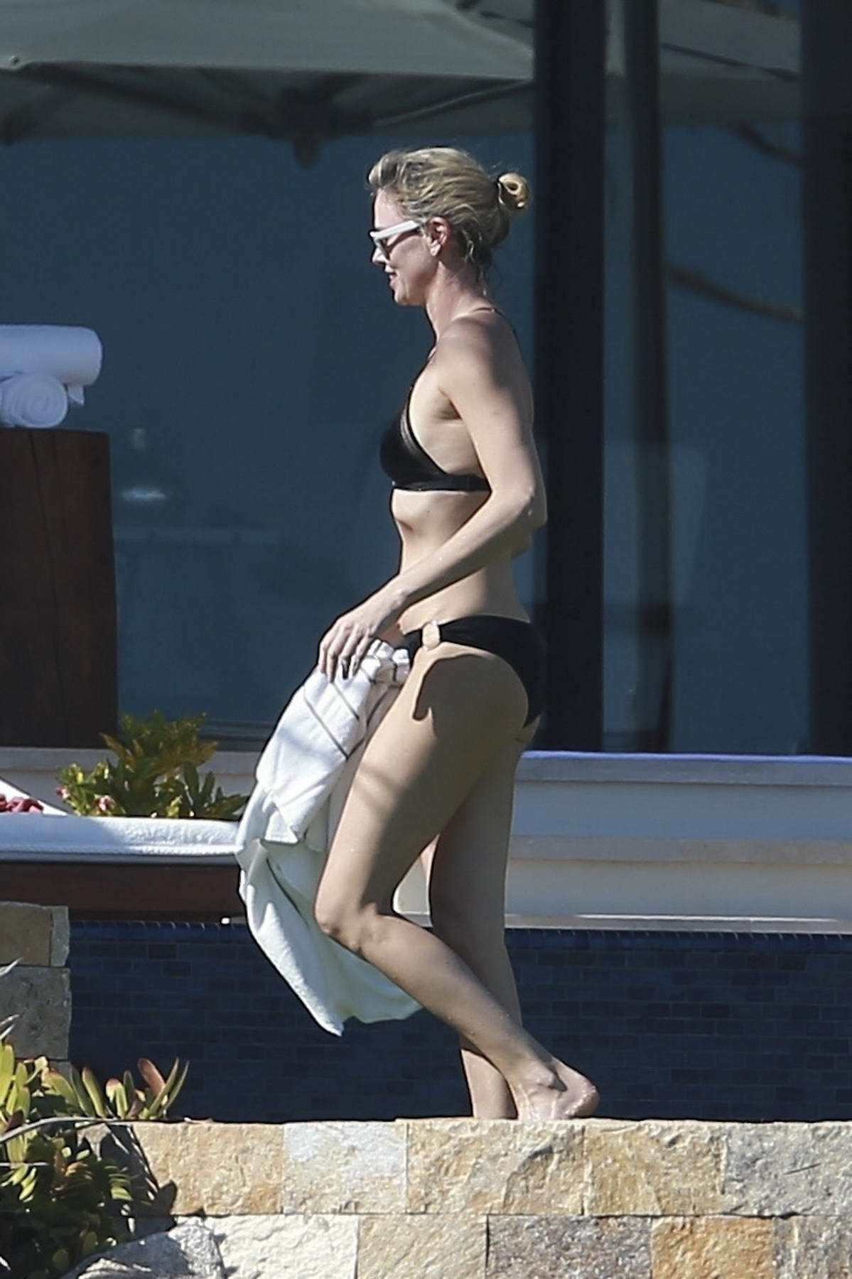 Charlize Theron in a black bikini spending thanksgiving weekend in Los Cabos, Mexico