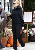 Charlotte McKinney in a black sweatsuit stops by a local bakery in Beverly Hills, Los Angeles