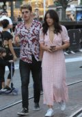 Chloe Bennet and Gregg Sulkin stroll side-by-side through The Grove in Hollywood, Los Angeles
