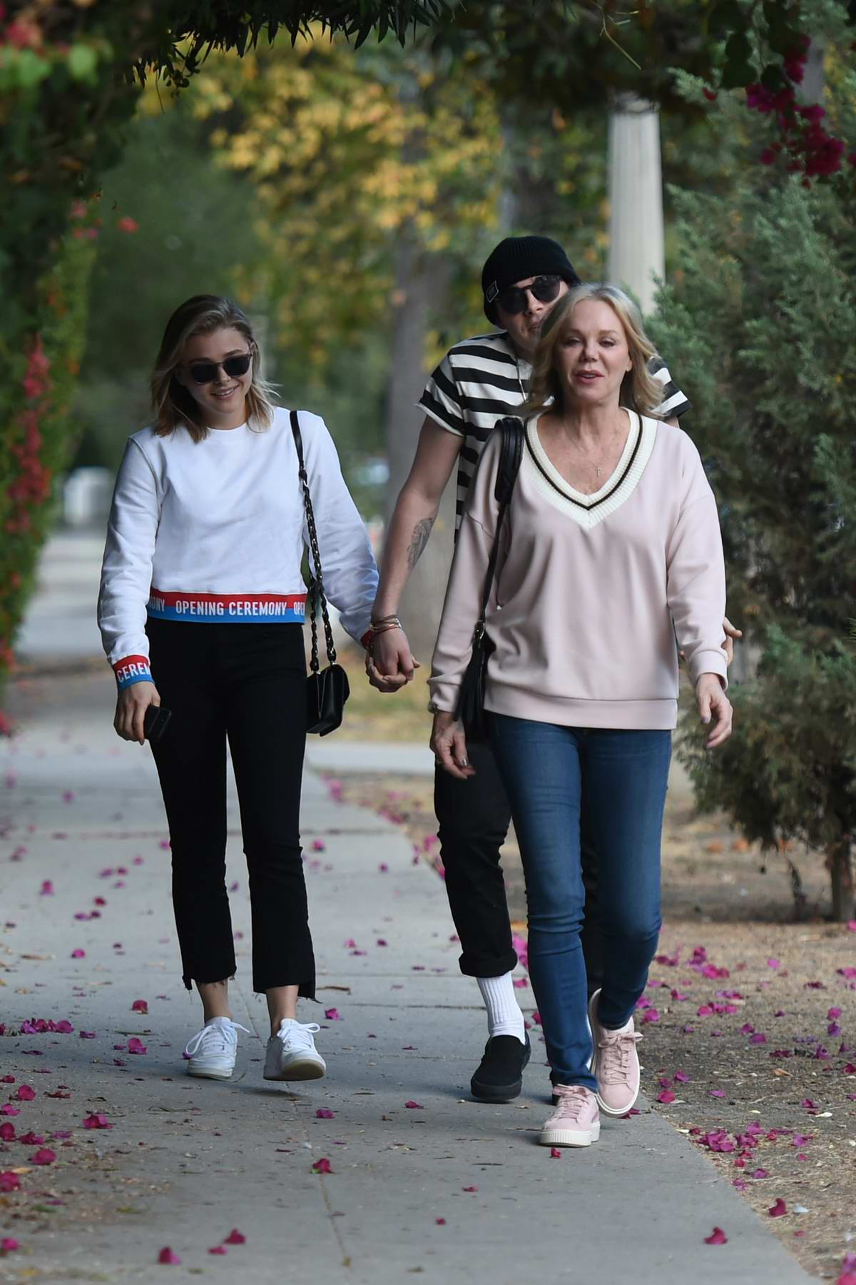 Chloe Grace Moretz and Brooklyn Beckham are joined by her mom on a walk to the nail salon in Los Angeles