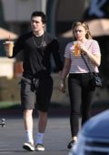 Chloe Grace Moretz and Brooklyn Beckham hold hands while picking up iced coffee in southern California