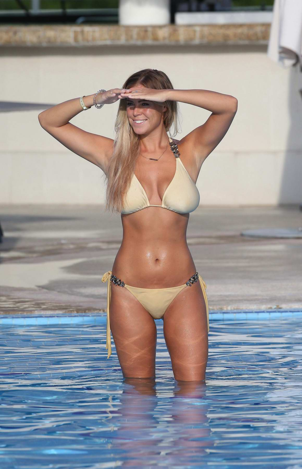 Chloe Meadows wearing a cream bikini while on holiday with boyfriend Taylor Barnett in Mexico