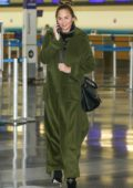 Chrissy Teigen in a green trench coat departs LAX Airport, Los Angeles