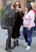 Dakota Johnson greet her fans while leaving her hotel in New York City