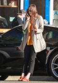 Dakota Johnson looked busy on her phone while she makes a coffee run, Los Angeles