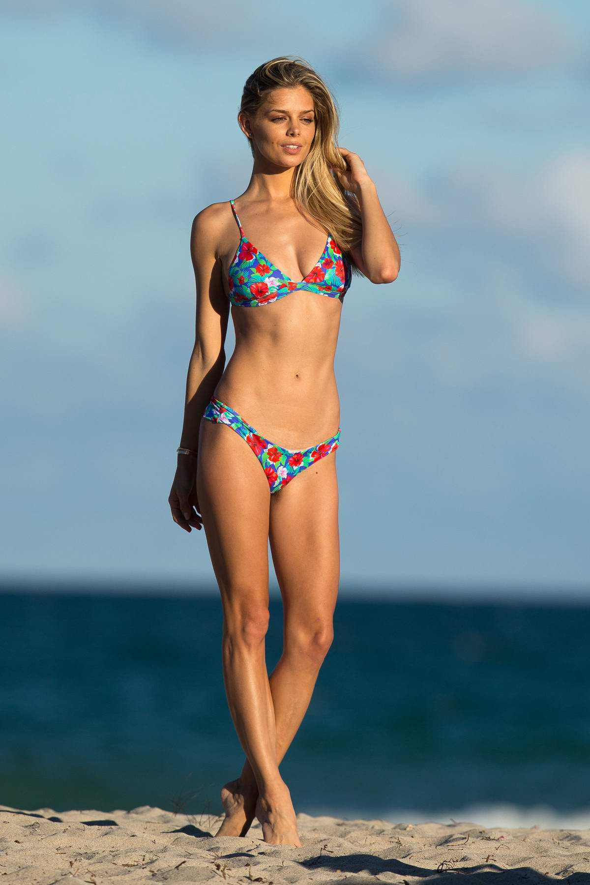 Danielle Knudson in a floral print bikini enjoying a day on the beach in Miami, Florida