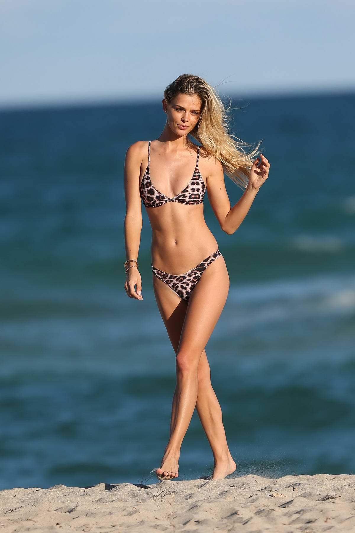 Danielle Knudson in a leopard print bikini during a photo shoot in Miami beach